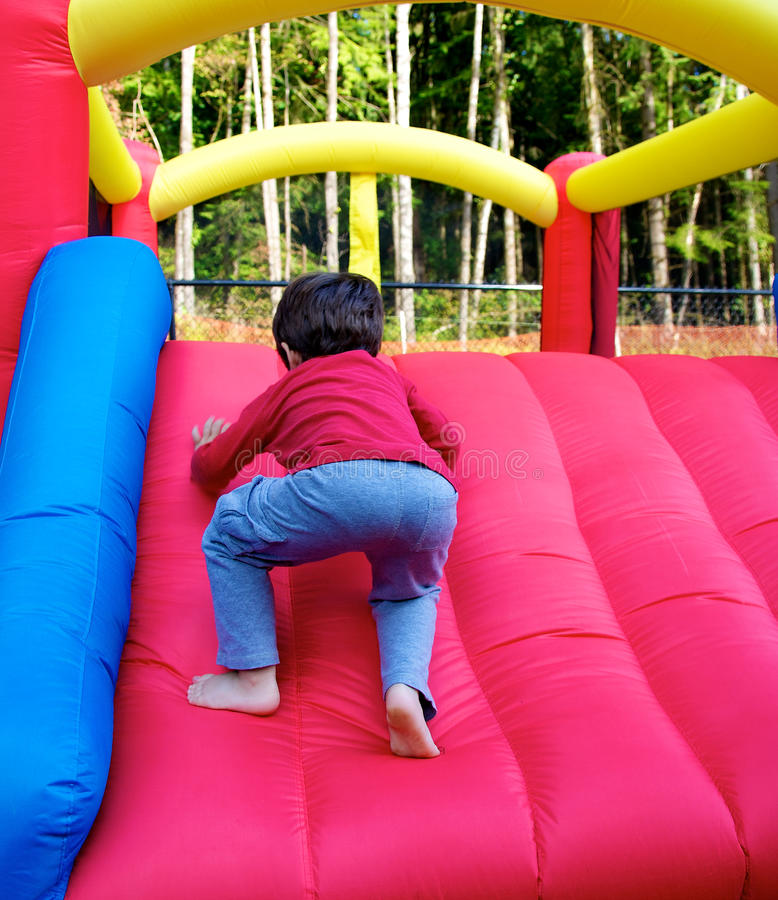Download Boy Climbing On Inflatable Castle Royalty Free Stock Image - Image: 26678996