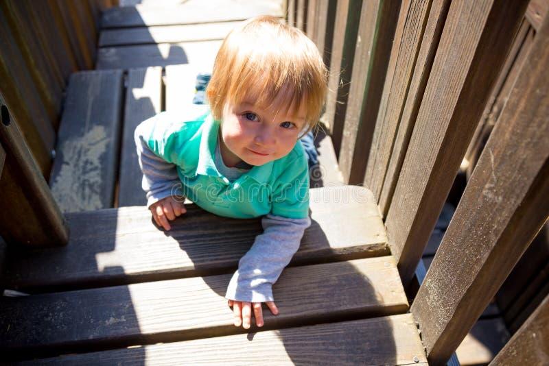 Boy Climbing Playground stock photo