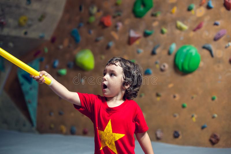 The boy is on the climbing wall. royalty free stock photos