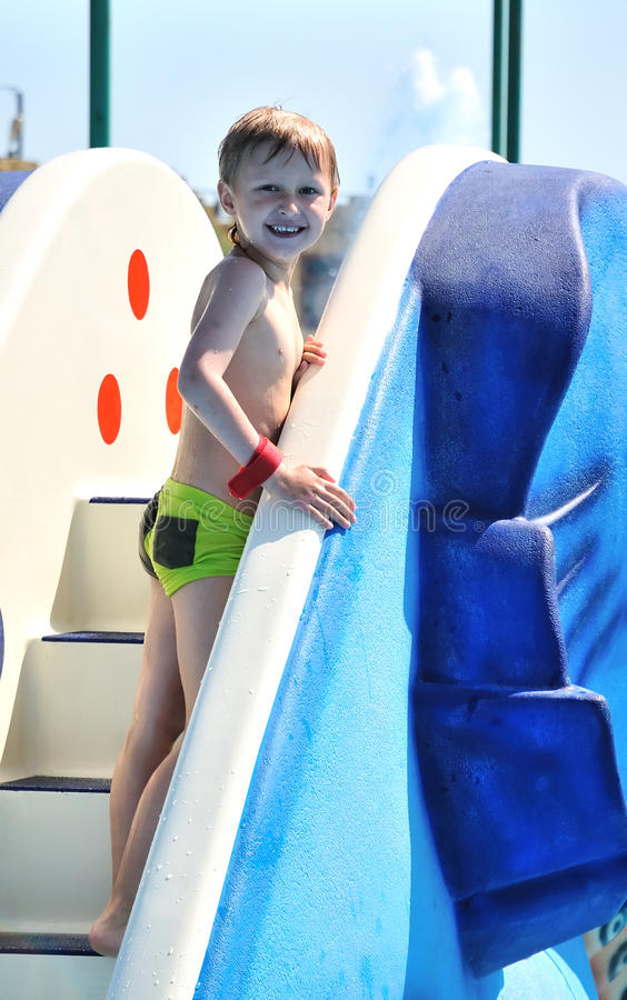 Boy climbing water slide
