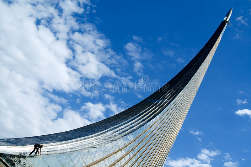 The boy climbs up a rocket a monument stock photography