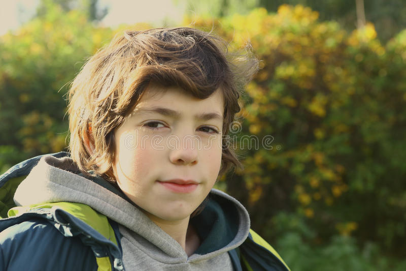 Boy close up portrait in autumn city park. Teen boy close up portrait in autumn city park stock photography