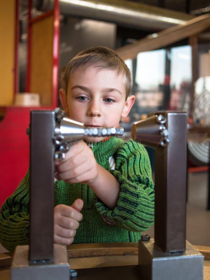 Boy closeup near the mechanism royalty free stock photography