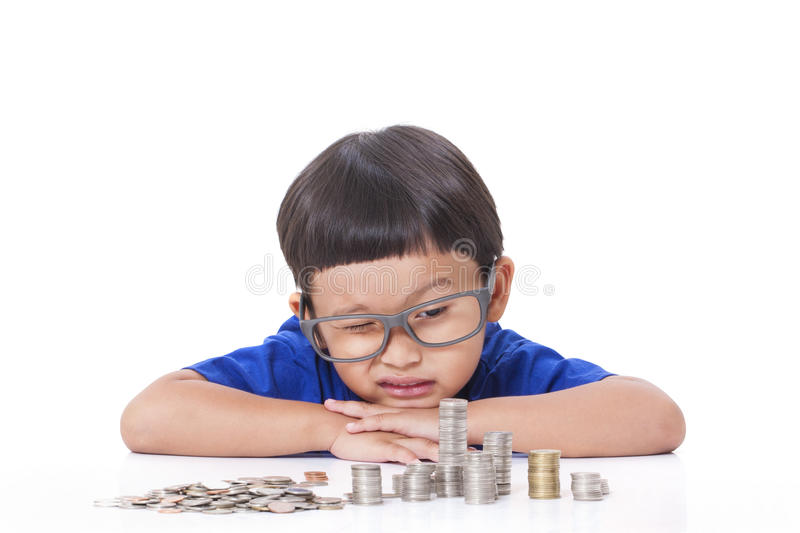 Boy with coins stock images