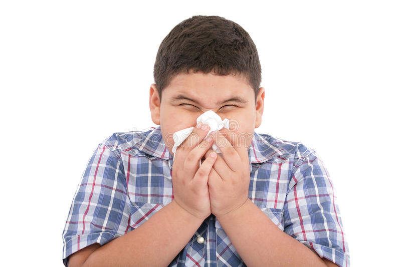 Boy with a cold. A young boy with a cold stock photo