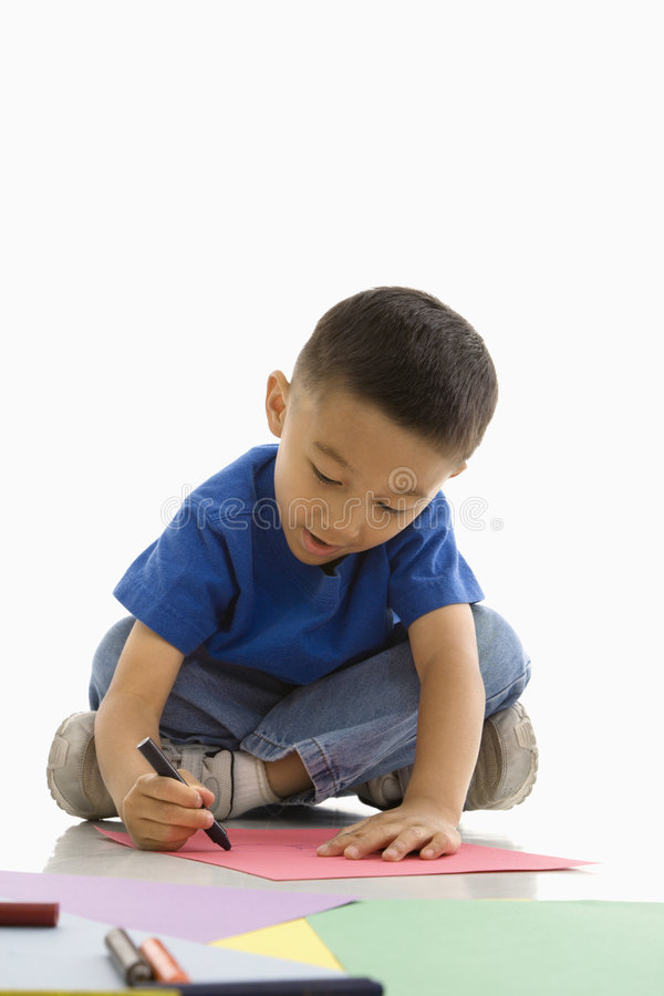 Boy coloring. royalty free stock photos