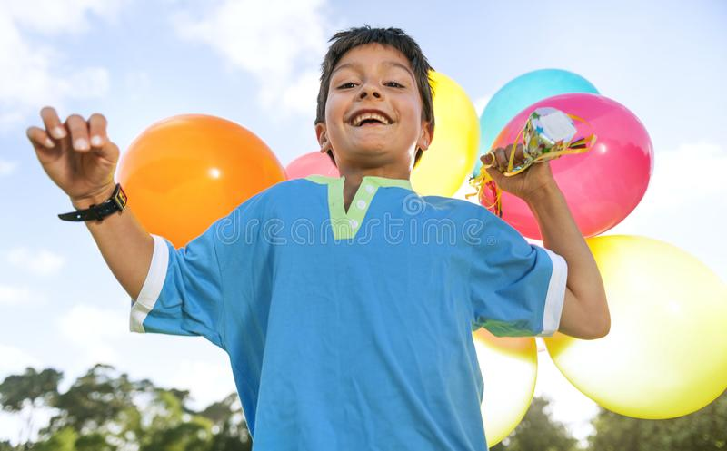 Boy with colourful balloons outdoor stock photo
