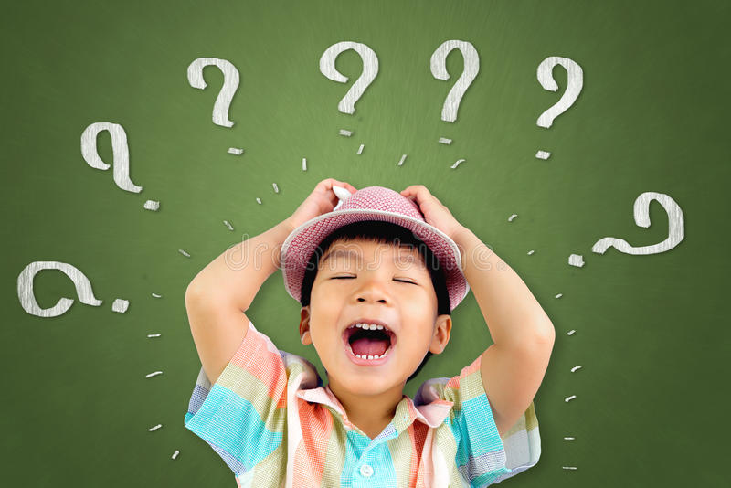 Boy is so confuse that he screaming out. Asian boy is so confuse that he screaming out stock photo