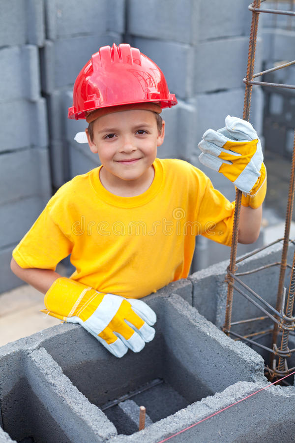 Boy at construction site. Vocational guidance - boy at construction site learning royalty free stock photos