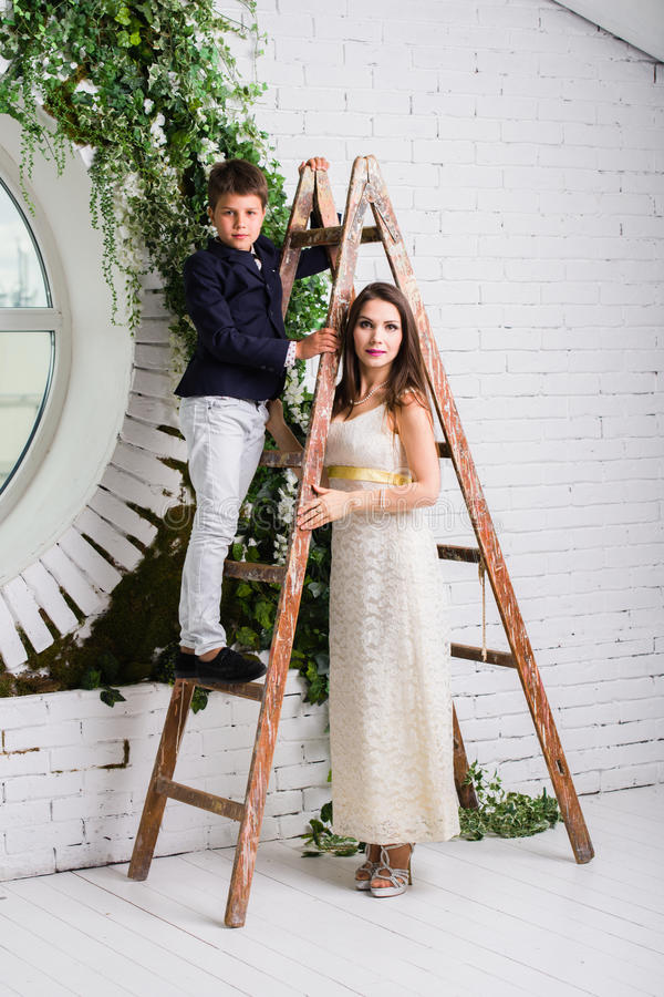The boy on the construction stairs and the girl supporting him royalty free stock photography
