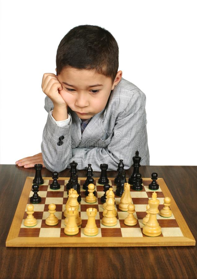 Download Boy Contemplating Chess Move Stock Photo - Image: 16057494