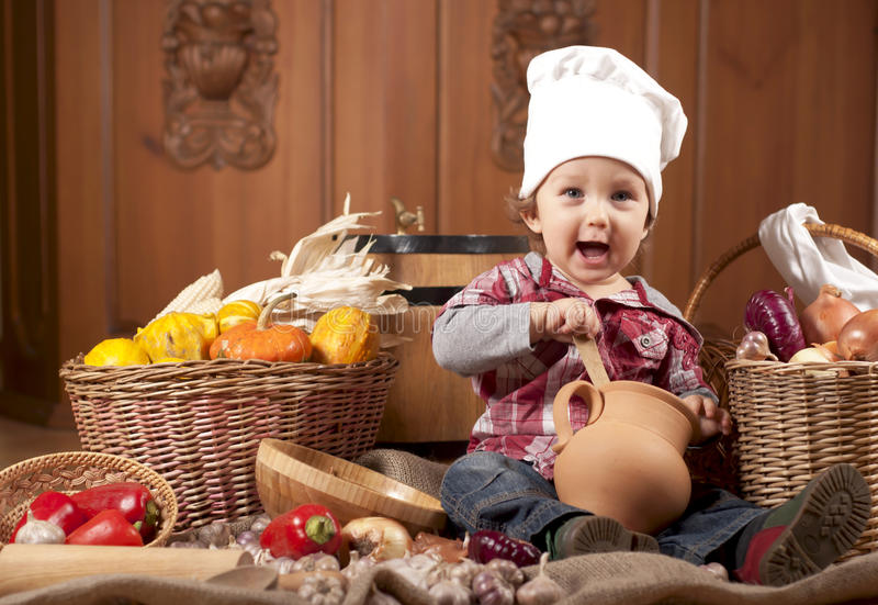 Download Boy In A Cook Cap Among Pans And Vegetables Stock Image - Image: 31117841