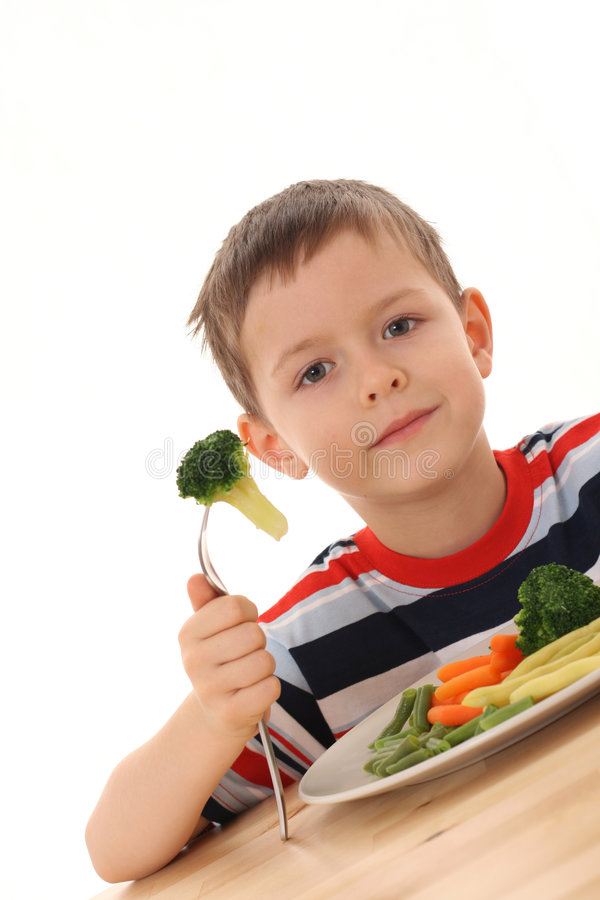 Boy And Cooked Vegetables Royalty Free Stock Images