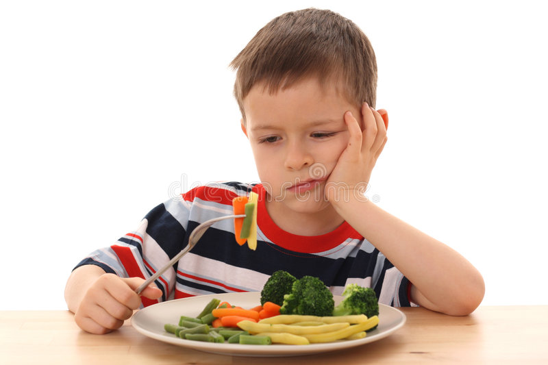 Boy and cooked vegetables royalty free stock image