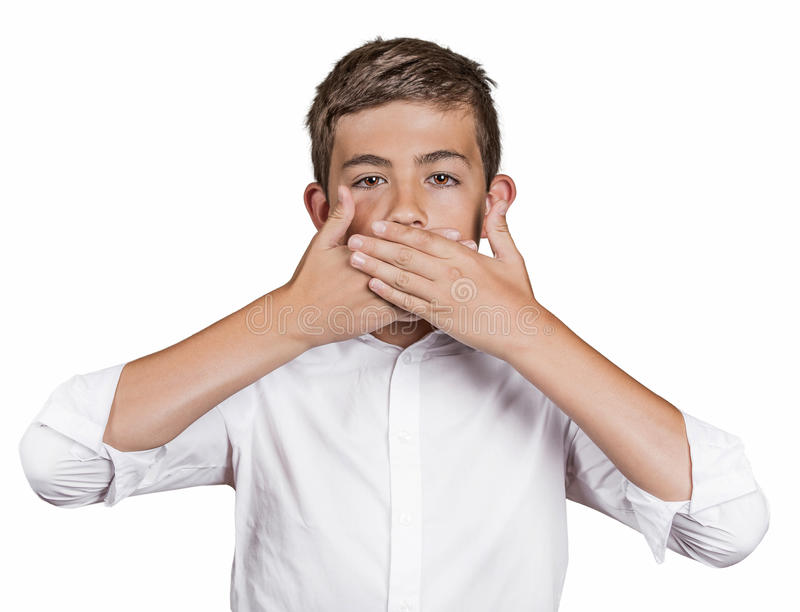 Boy, covering his mouth with hands won't talk. Speak no evil. Portrait young man, student, boy, covering his mouth with hands won't talk. Speak no evil concept royalty free stock image