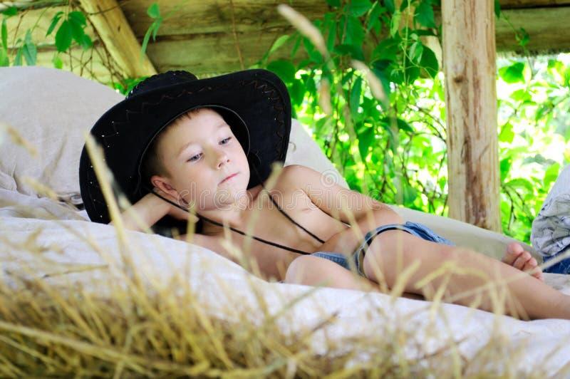 Boy in a cowboy hat stock photos