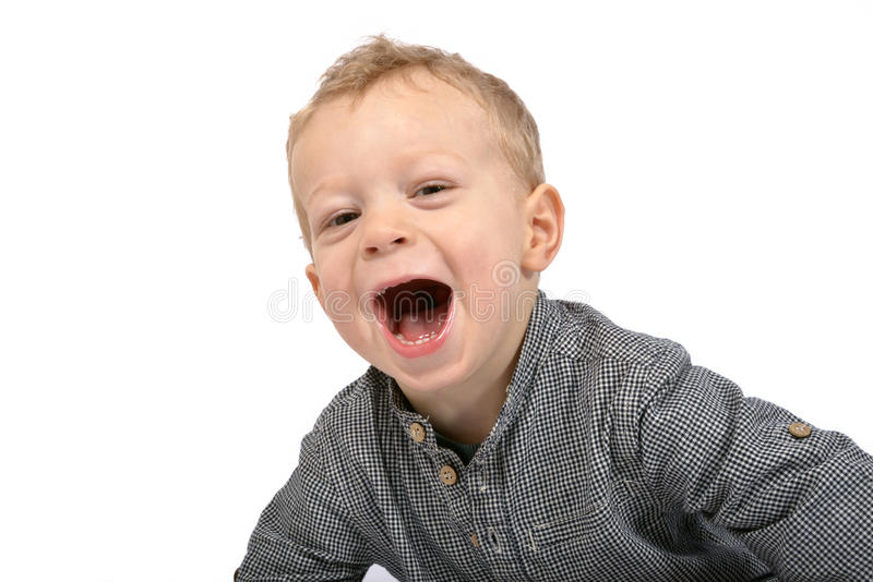 Boy cry. Boy dressed with a blue checkered shirt cry royalty free stock images