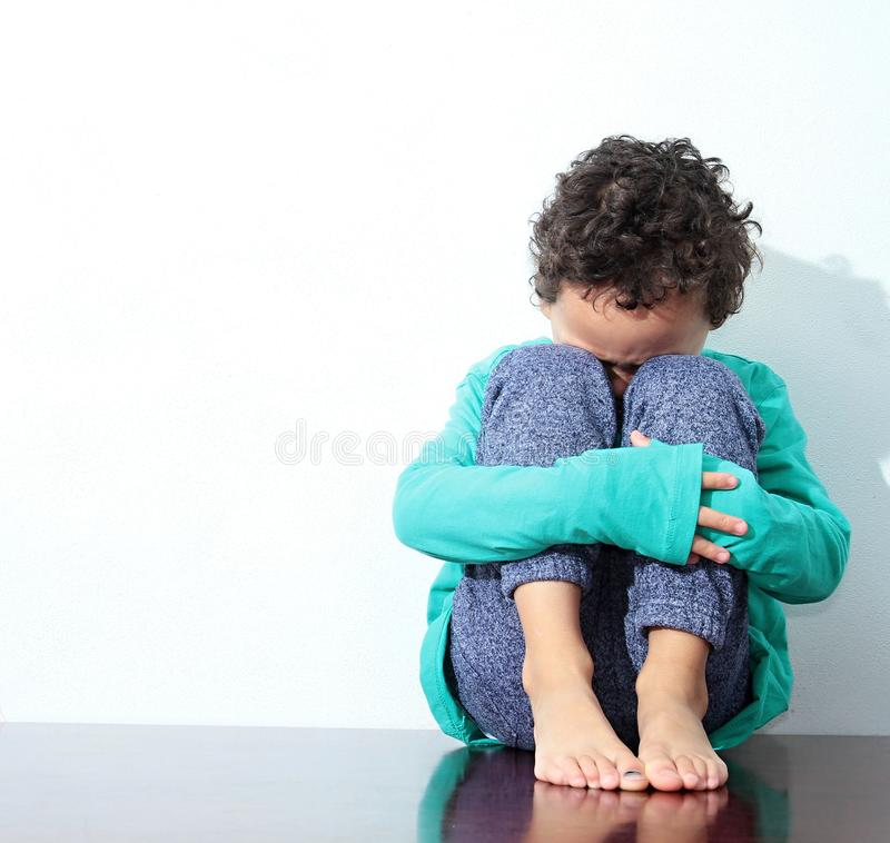 Boy crying in poverty stock photo