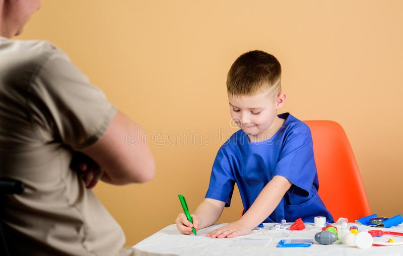 Boy cute child and his father doctor. Medical examination. Child care kindergarten. Hospital worker. Medical service royalty free stock photography