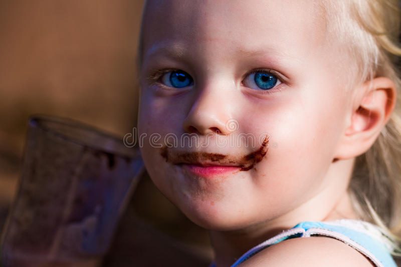 Boy with a cute chocolate moustache stock images