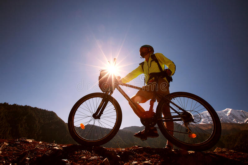 Boy cycling at the road stock photo