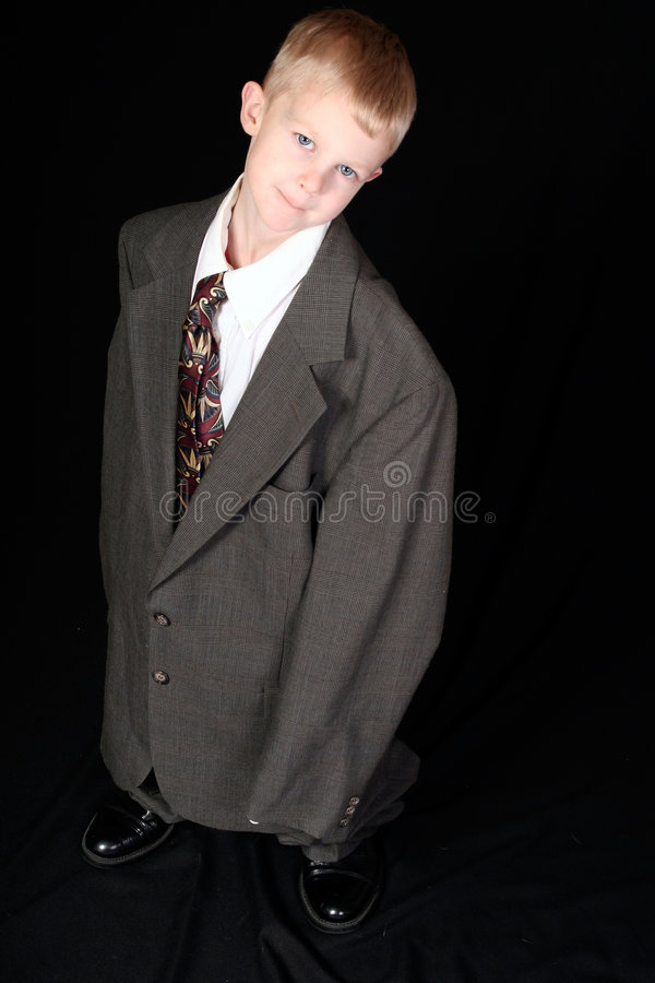 Boy in Dad's Business Suit stock photography