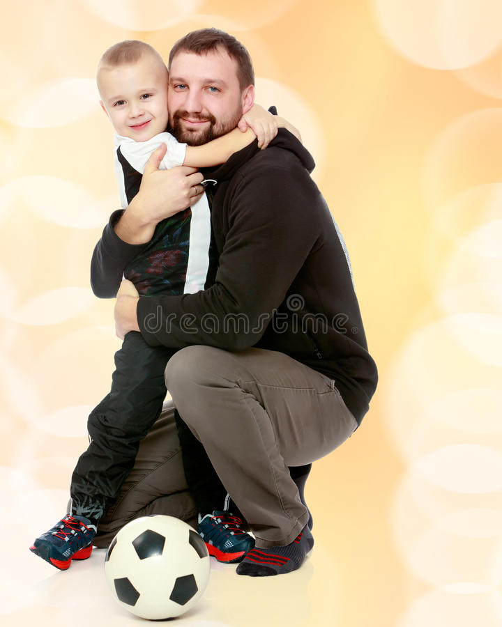Boy, a dad, and a soccer ball. royalty free stock photo