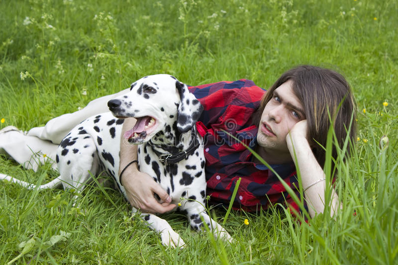 Boy and the dalmatian dog stock photography