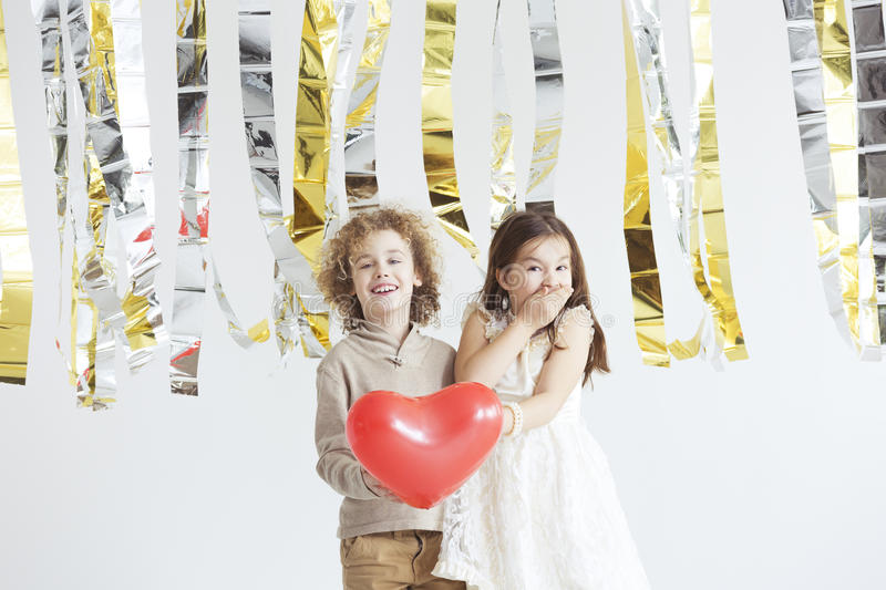 Boy declaring love to friend. Small boy declaring love to his cute friend royalty free stock photo