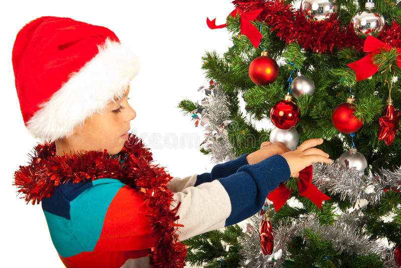 Boy Decorate Christmas Tree Royalty Free Stock Image