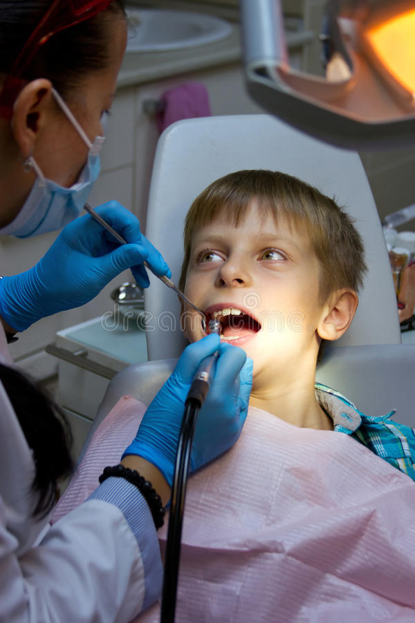 Boy in a dental surgery royalty free stock image
