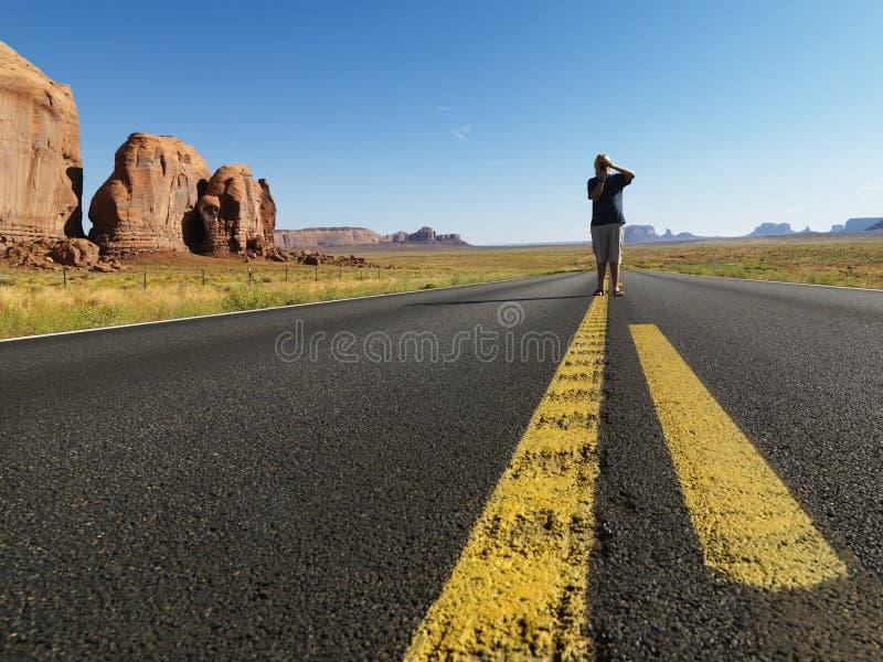 Boy in desert road.