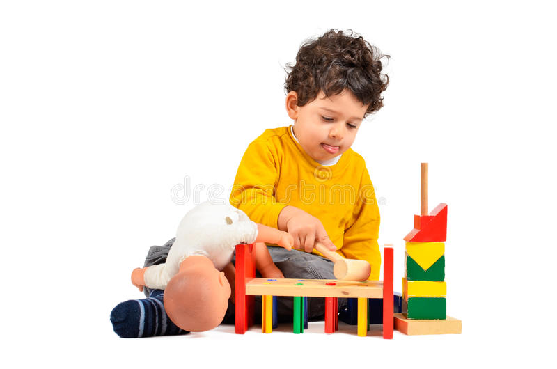 Boy and didactic toys stock photo