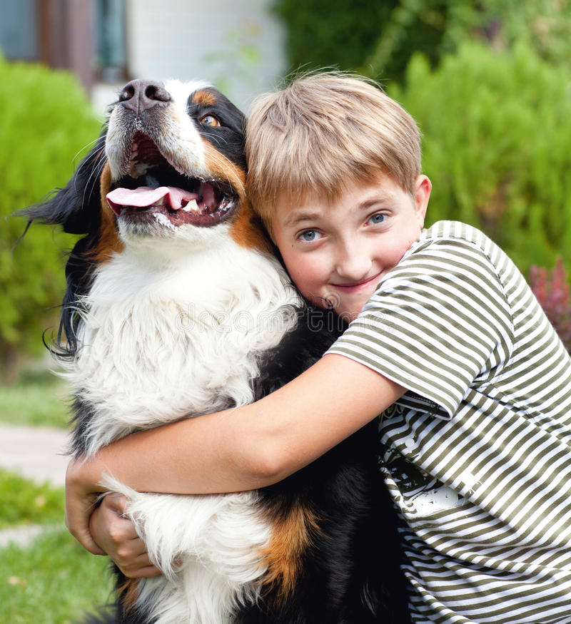 Boy and dog stock photography