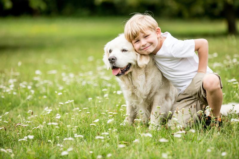 Boy and dog together as friends. Happy boy and dog together as friends as love of animals concept royalty free stock photo