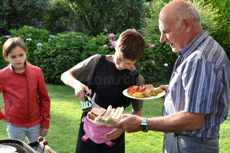 Boy doing barbecue royalty free stock photography