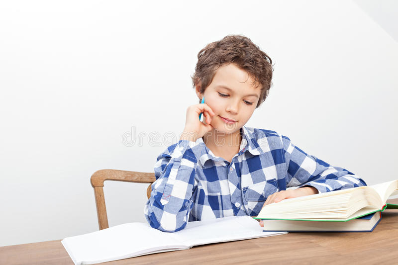 A boy is doing his homework