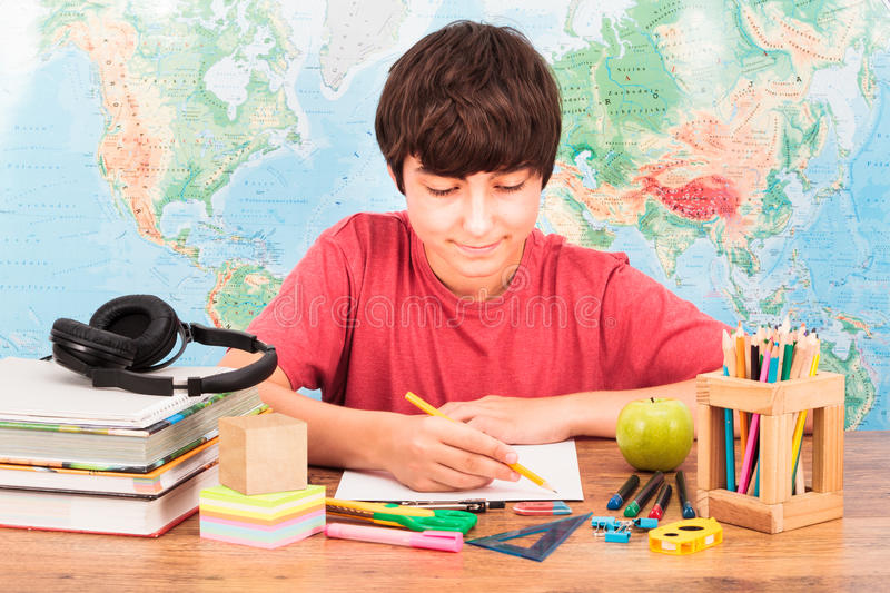 Boy doing his homework. Young boy doing his homework royalty free stock images