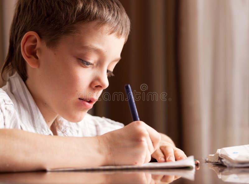 Boy doing homework. Child education stock photo