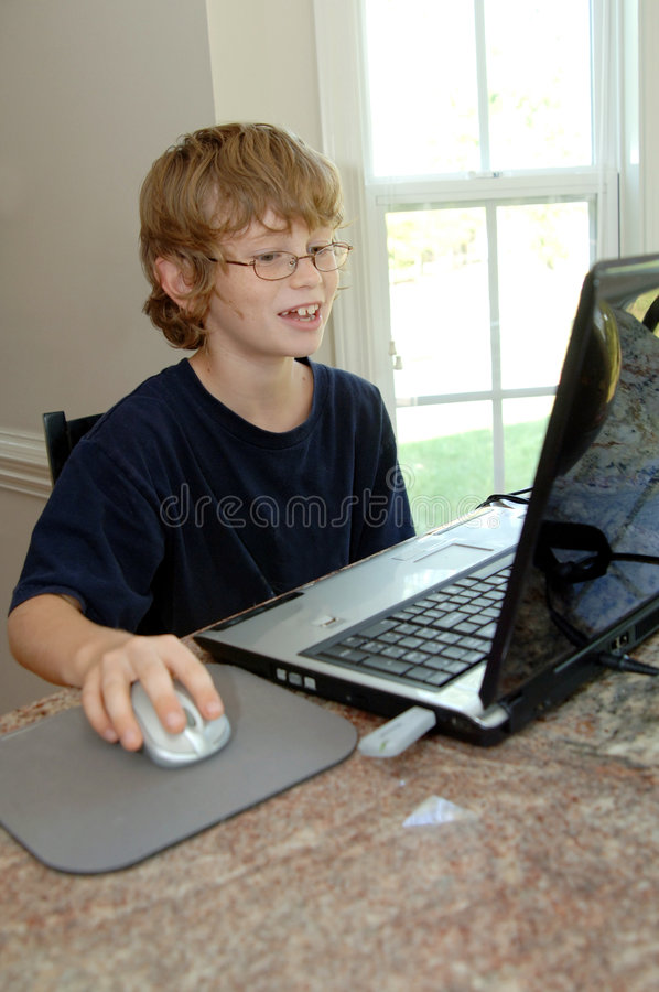 Boy doing homework on computer royalty free stock images