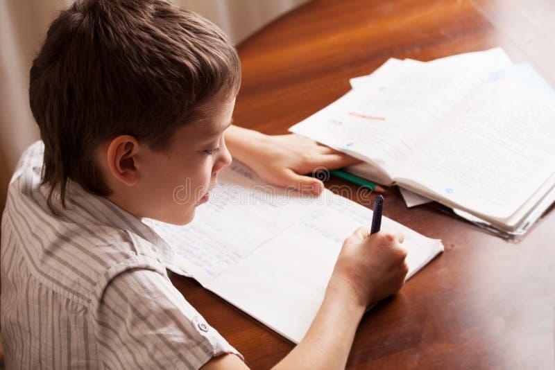 Boy doing homework at home. Boy doing homework. Child education royalty free stock photography