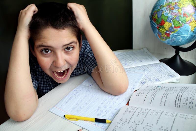 Boy doing math homework stock photography