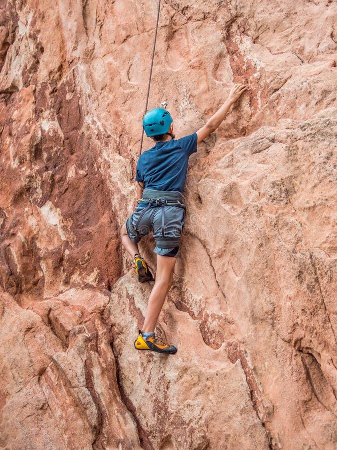 A boy doing rock climbing royalty free stock photography