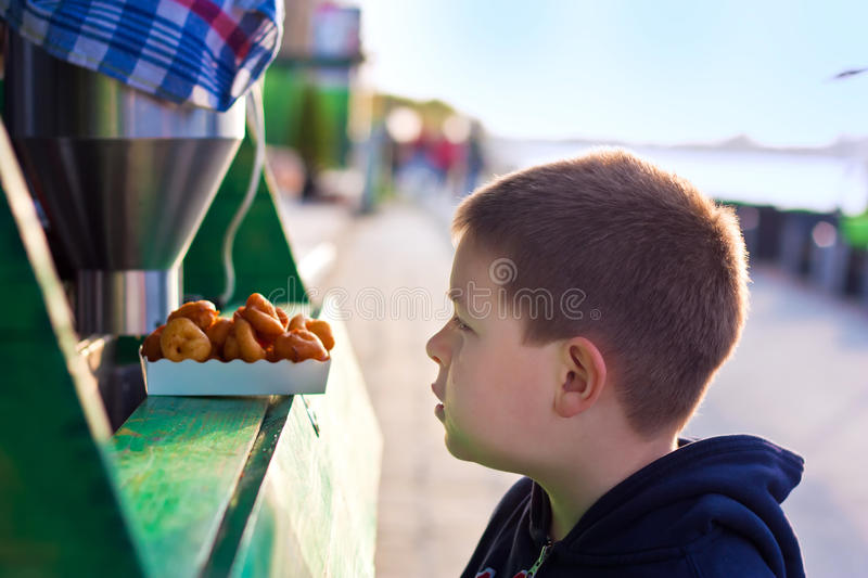 Boy with donuts stock image