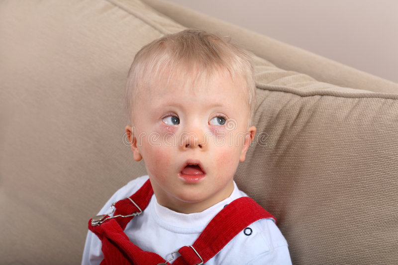 Boy with Down syndrome stock images