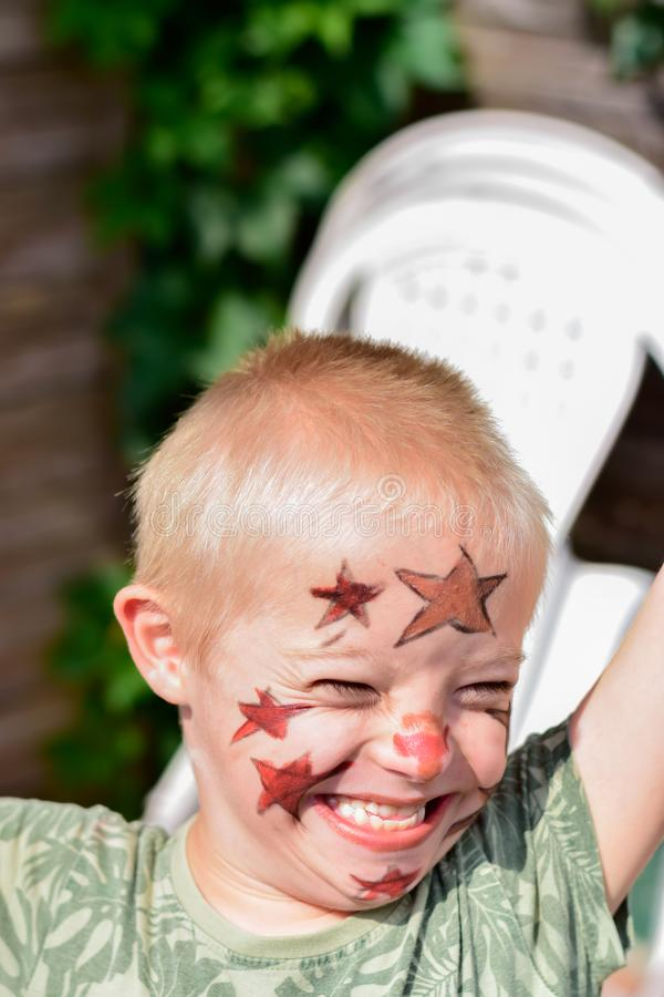 Boy with down syndrome. Boy with down syndrome, prepared and painted for home theater royalty free stock images