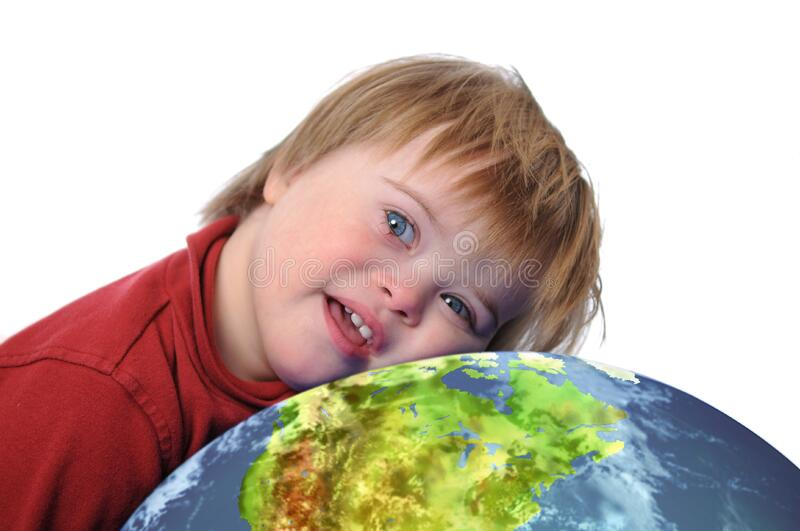 Boy with down syndrome and earth stock photography