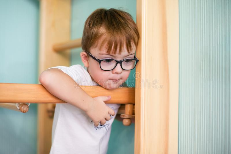 Boy with down syndrome. At home royalty free stock photo