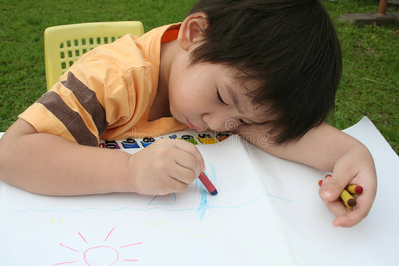 Boy drawing stock photography