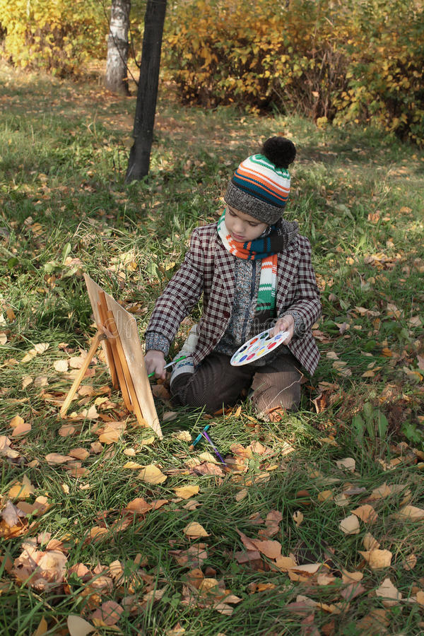 Download Boy Drawing Outdoor In Autumn Stock Photo - Image of jacket, grass: 21669516